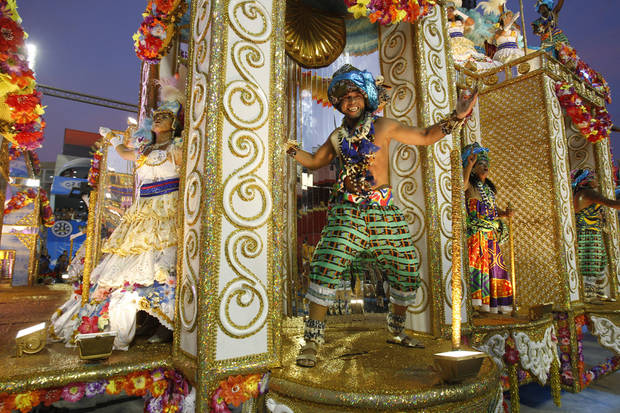 Performers from the Unidos da Vila Isabel samba school parade during carnival celebrations at the Sambadrome in Rio de Janeiro, Brazil, Monday, Feb.20, 2012.   Millions watched the sequin-clad samba dancers at Rio de Janeiro's iconic Carnival parade.  (AP Photo/Victor R. Caivano) ORG XMIT: XSI172