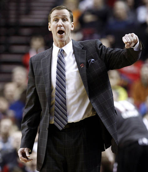 Portland Trail Blazers head coach Terry Stotts disagrees with a call during the first quarter of an NBA basketball game against the Cleveland Cavaliers in Portland, Ore., Wednesday, Jan. 16, 2013. (AP Photo/Don Ryan)
