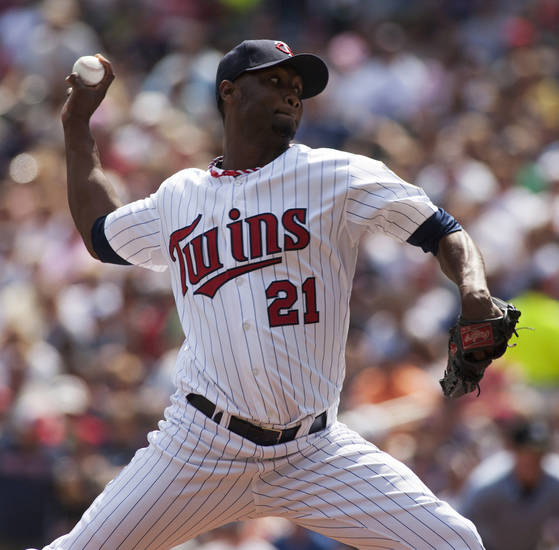 Minnesota Twins starting pitcher Samuel Deduno (21) delivers against the Chicago White Sox during the first inning of a baseball game on Sunday, Aug. 18, 2013, in Minneapolis. (AP Photo/Paul Battaglia)