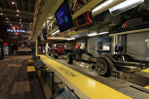 A 1975 Cadillac assembly line is displayed at the Detroit Historical Museum in Detroit, Wednesday, Nov. 21, 2012. The museum is reopening six months after the venerable institution in the city�s cultural center closed up shop to undergo its first major renovation in a half-century. (AP Photo/Carlos Osorio)
