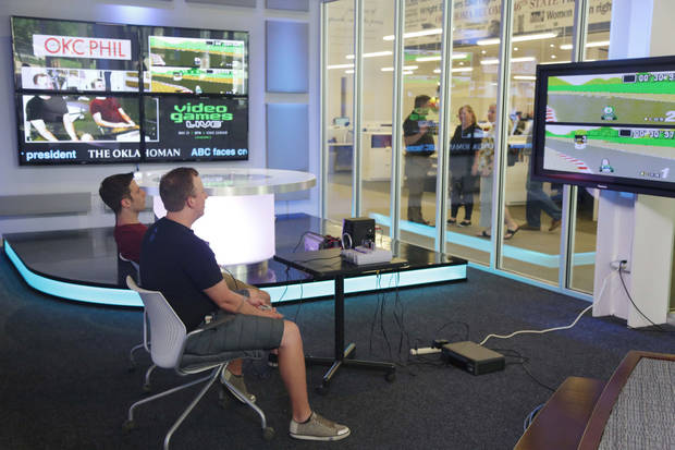 Gage Alleman and Shaun Wright play a video game The Oklahoman's Big Screen Mario Kart tournament on May 15, 2015.
