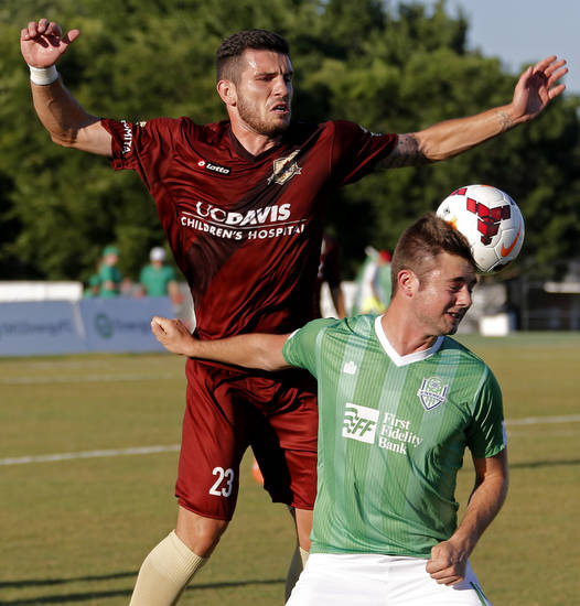 Pete Caringi III with the Oklahoma City Energy FC goes for the ball beside Emrah Klimenta of the Sacramento Republic FC during a soccer game in Oklahoma City, Saturday, June 14, 2014. Photo by Bryan Terry, The Oklahoman