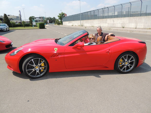 Tricia Tramel drives a Ferrari in Maranello, Italy, with her husband in the back seat. (Photo Provided)