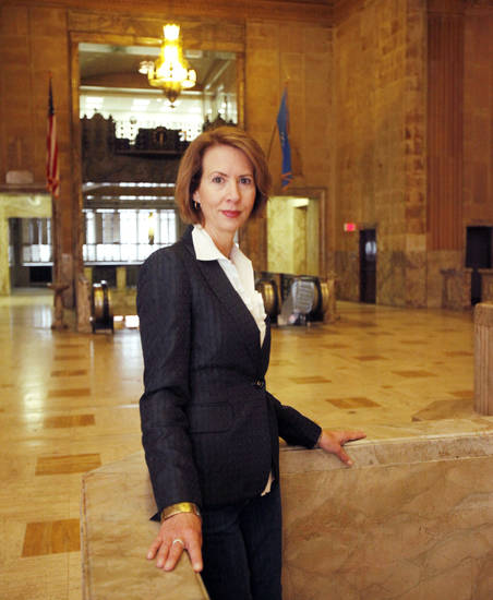 Jill Simpson, with the Oklahoma Tourism Dept., poses in the lobby of the First National Center in downtown Oklahoma City, OK, Thursday, Sept. 22, 2011. By Paul Hellstern, The Oklahoman
