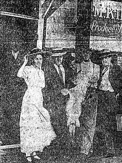 Mrs. W.H. Edmond, of near Lawton, and her 63 and 1/2-pound fish with her witnesses, Mr. Edmond and Omer and Earl Hunter.