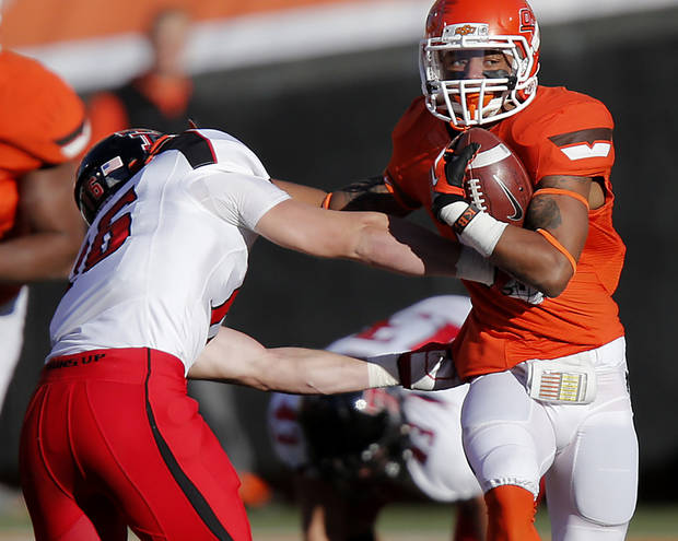 Oklahoma State's Josh Stewart (5) runs past Texas Tech's Cody Davis (16) during the college football game between the Oklahoma State University Cowboys (OSU) and Texas Tech University Red Raiders (TTU) at Boone Pickens Stadium on Saturday, Nov. 17, 2012, in Stillwater, Okla.   Photo by Chris Landsberger, The Oklahoman