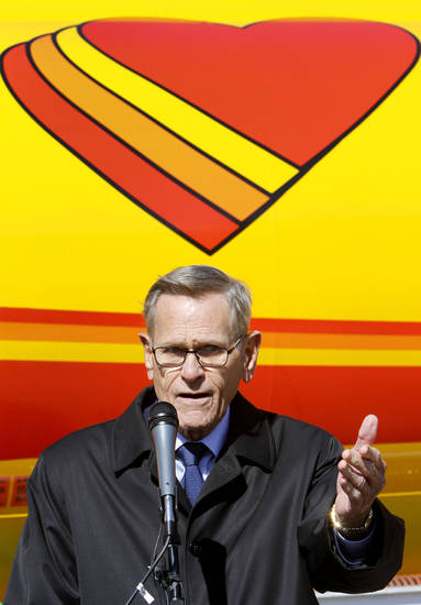 "Tom Love, founder and CEO of Love's Travel Stops, speaks Monday during the opening of Love's first ""fast fill"" CNG facility for heavy-duty trucks at Interstate 40 and Morgan Road in Oklahoma City. Photo By Steve Gooch, The Oklahoman <strong>Steve Gooch</strong>"