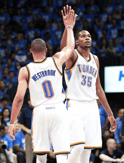 Russell Westbrook and Kevin Durant. <strong>Sue Ogrocki - AP</strong>