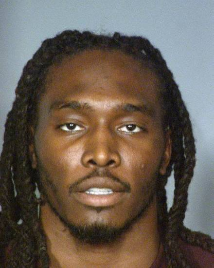 In an image provided by the Las Vegas Metropolitan Police Department, Denver Broncos safety Quinton Carter appears in a photo in Las Vegas. Carer is facing felony charges following his arrest last weekend on allegations that he cheated at a Las Vegas casino craps game. (AP Photo/Las Vegas Metropolitan Police Department) ORG XMIT: RPKR101