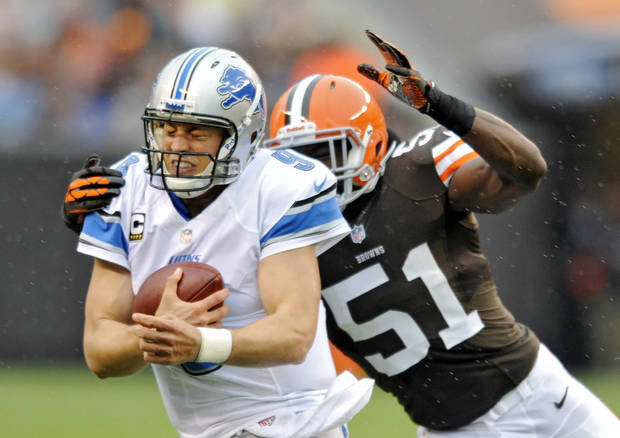 Detroit Lions quarterback Matthew Stafford is chased by Cleveland Browns linebacker Barkevious Mingo in the second quarter of an NFL football game Sunday, Oct. 13, 2013 in Cleveland. (AP Photo/David Richard)