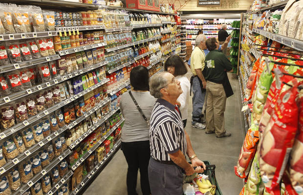 Shoppers on an aisle at  Whole Foods Market that opened in Oklahoma City Wednesday, Oct.12, 2011. Photo by Paul B. Southerland, The Oklahoman
