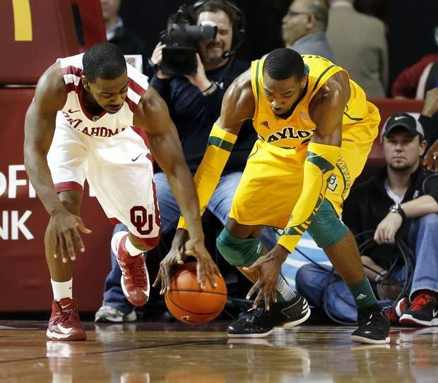 Oklahoma Sooner's Sam Grooms (1) and Baylor Bear's Cory Jefferson (34) fight for a loose ball as the University of Oklahoma Sooners (OU) men play the Baylor University Bears (BU) in NCAA, college basketball at The Lloyd Noble Center on Saturday, Feb. 23, 2013 in Norman, Okla. Photo by Steve Sisney, The Oklahoman