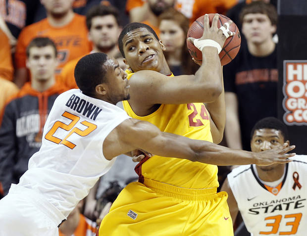 Oklahoma State Cowboys' Markel Brown (22) defends on Iowa State Cyclones' Percy Gibson (24) during the college basketball game between the Oklahoma State University Cowboys (OSU) and the Iowa State University Cyclones (ISU) at Gallagher-Iba Arena on Wednesday, Jan. 30, 2013, in Stillwater, Okla.  Photo by Chris Landsberger, The Oklahoman