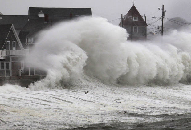Waves crash into a seawall and buildings along the coast in Hull, Mass., Wednesday, Nov. 7, 2012. A high-wind warning is in effect in the state until Wednesday night, with gusts of up to 60 mph expected in some costal areas, and 50 mph gusts expected for Boston and western Massachusetts. (AP Photo/Steven Senne)