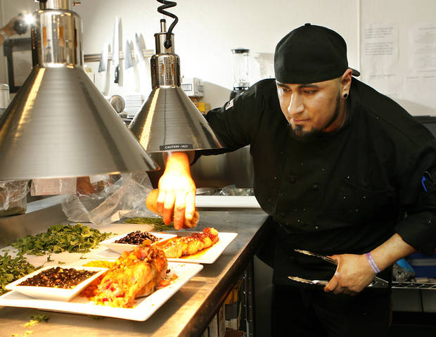 Chef Victor Izeta puts finishing touches on dishes before they leave the kitchen of Bolero Tapas Bar &amp; Spanish Grill, Feb. 13, 2009.  BY JIM BECKEL, THE OKLAHOMAN ORG XMIT: KOD