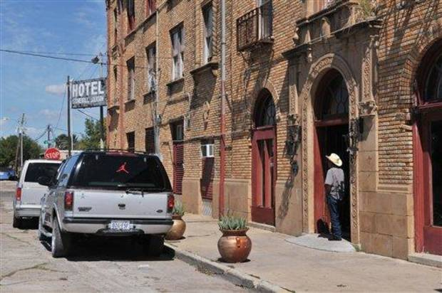 This Sept. 10, 2012 photo shows the Stonewall Jackson hotel in San Benito, Texas. Built in 1927, the grand hotel served as the center of society in the town that became an agricultural hub.  (AP Photo/Valley Morning Star, Dina Arevalo)