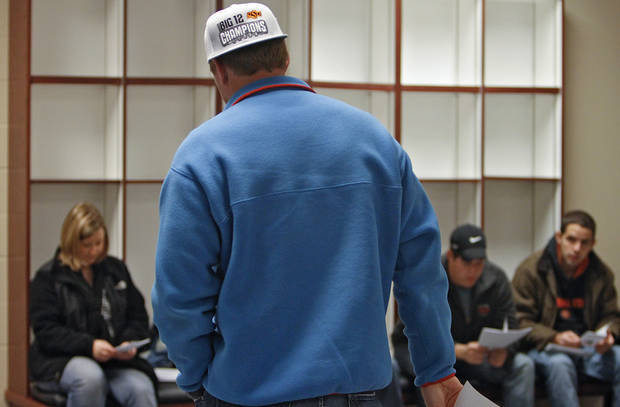 OKLAHOMA STATE UNIVERSITY COLLEGE FOOTBALL QUARTERBACK: Wearing his Big 12 Championship hat, Oklahoma State quarterback Brandon Weeden stands in front of his golf class while giving a presentation on golfer Scott Verplank at OSU's Colvin Center in Stillwater, Okla. on Thursday, Dec. 8, 2011. Photo by Chris Landsberger, The Oklahoman