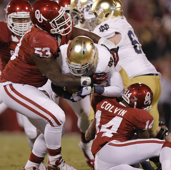OU's Casey Walker (53) and Aaron Colvin (14) stop Notre Dame 's Cierre Wood (20) during the college football game between the University of Oklahoma Sooners (OU) and the Notre Dame Fighting Irish at the Gaylord Family-Oklahoma Memorial Stadium on Saturday, Oct. 27, 2012, in Norman, Okla. Photo by Chris Landsberger, The Oklahoman