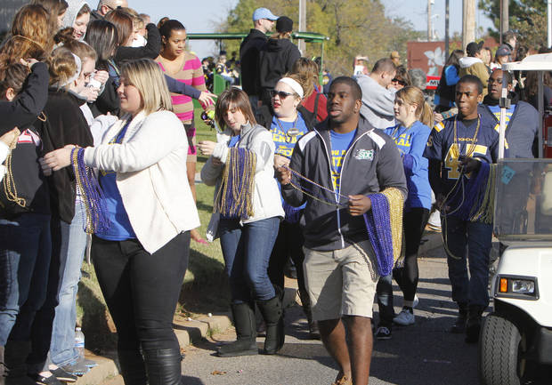 UCO students pass out beads to the crowds during the University of Central Oklahoma's homecoming parade in Edmond, OK, Saturday, November 3, 2012,  By Paul Hellstern, The Oklahoman