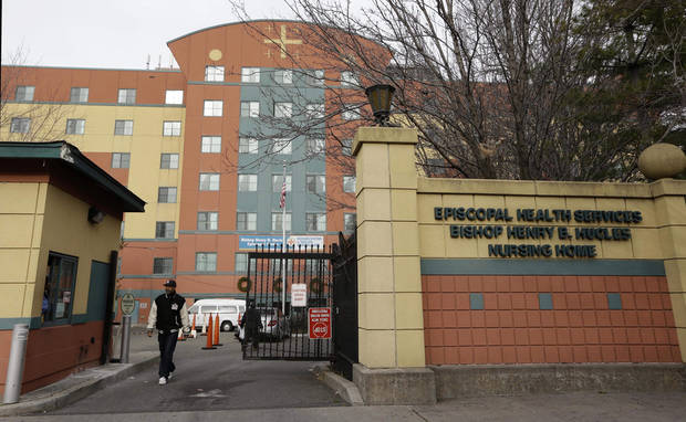 FILE - This file photo of Dec. 24, 2012, shows the Bishop Henry B. Hucles Episcopal Rehabilitation and Skilled Nursing Center in New York. The facility, located in the Bedford Stuyvesant section of Brooklyn, was swollen to nearly double its licensed capacity by elderly and disabled New Yorkers it took in after they were evacuated from seaside nursing homes and assisted living residences following Superstorm Sandy. The nursing home and an assisted living facility are under scrutiny by state officials and advocacy groups after revelations that residents forced to evacuate by Hurricane Sandy were still living in cramped, and sometimes oppressive temporary quarters two months after the storm.   (AP Photo/Kathy Willens, File)