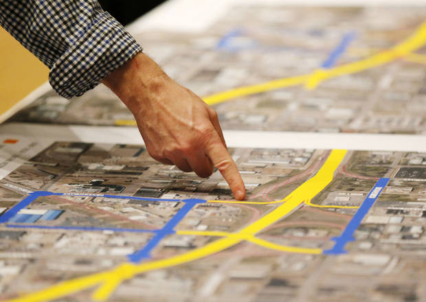 A man looks at a proposed design for the Oklahoma City Boulevard as it crosses Western, before a public meeting at the Coca-Cola Bricktown Events Center in Oklahoma City, Monday, Dec. 3, 2012. Photo by Nate Billings, The Oklahoman <strong>NATE BILLINGS - NATE BILLINGS</strong>