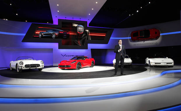 Mark Reuss, General Motors vice president and president for North America, talks Monday about the  2014 Chevrolet Corvette Stingray, second from left, at media previews for the North American International Auto Show in Detroit. AP Photo <strong>Paul Sancya</strong>