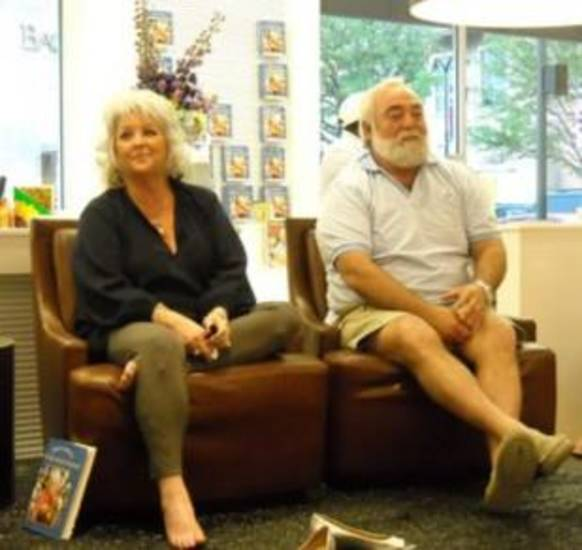 Paula Deen relaxing at a book signing in Dallas. Check out her leggings.