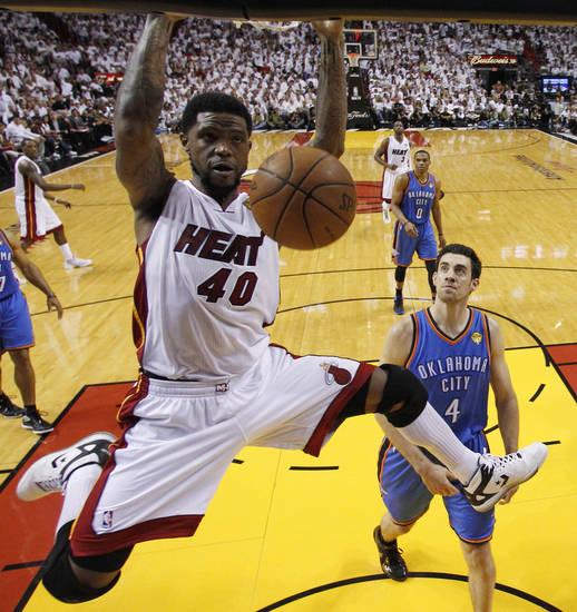 Miami Heat power forward Udonis Haslem (40) dunks against the Oklahoma City Thunder during the second half at Game 3 of the NBA Finals basketball series, Sunday, June 17, 2012, in Miami. Miami won 91-85. (AP Photo/Lynne Sladky, Pool) ORG XMIT: NBA157