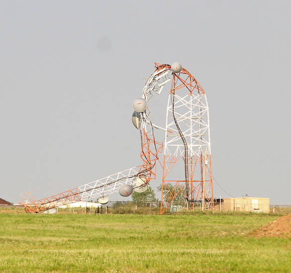 A cellphone tower lies crumpled on the east side of Lawton after high winds from a storm hit Monday. . PHOTO BY Brandson Neris, Lawton Constitution