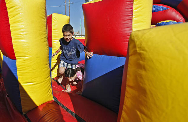 Mitchell Suttle, 8, races his sister Abigail, 6, through the obstacle course in the fan fest area during the Oklahoma Regatta Festival at the Oklahoma River on Saturday, Oct. 1, 2011, in Oklahoma City, Okla. Photo by Chris Landsberger, The Oklahoman