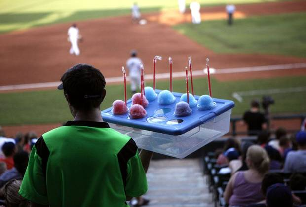 Bryant Preston sells snow cones during the minor league baseball game between the Oklahoma City RedHawks and the Omaha Storm Chasers at RedHawks Field at Bricktown, Saturday, July 9, 2011. Photo by Sarah Phipps, The Oklahoman ORG XMIT: KOD