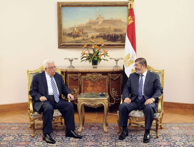 "In this photo, released by the Egyptian Presidency, Palestinian President Mahmoud Abbas, left, meets with Egyptian President Mohammed Morsi, right, in Cairo Egypt, Tuesday, Nov. 13, 2012. In a meeting in Cairo Tuesday with Western-backed Palestinian President Mahmoud Abbas, Morsi expressed his ""full support"" for Palestinian plans to seek nonmember state status at the United Nations.(AP Photo/Egyptian Presidency)"