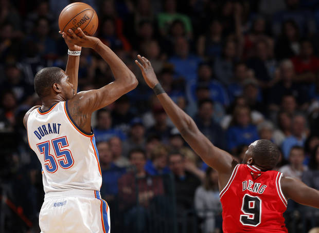 Oklahoma City's Kevin Durant (35) shoots over Chicago's Luol Deng (9) during the NBA game between the Oklahoma City Thunder and the Chicago Bulls at Chesapeake Energy Arena in Oklahoma City, Sunday, Feb. 24, 2013. Photo by Sarah Phipps, The Oklahoman