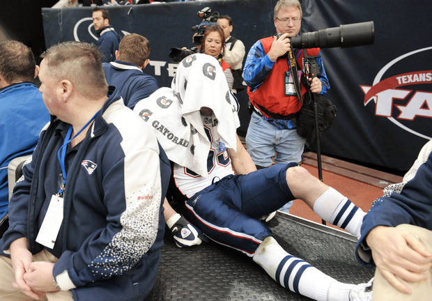 New England receiver Wes Welker is driven off the field after suffering a season-ending knee injury on Jan. 3 in Houston. AP photos