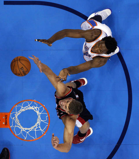 Oklahoma City Thunder's Hasheem Thabeet, top, and Portland Trail Blazers' Meyers Leonard fight for a rebound as the Oklahoma City Thunder defeat the Portland Trail Blazers 106-92 in NBA basketball at the Chesapeake Energy Arena in Oklahoma City, on Friday, Nov. 2, 2012.  Photo by Steve Sisney, The Oklahoman