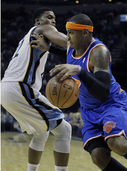 New York Knicks' Carmelo Anthony, right, pushes Memphis Grizzlies' Rudy Gay away during the first half of an NBA basketball game in Memphis, Tenn., Friday, Nov. 16, 2012. (AP Photo/Danny Johnston)