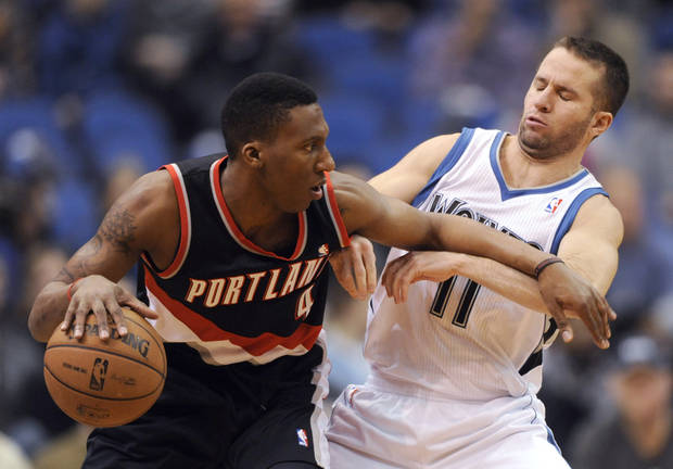 Minnesota Timberwolves' J.J. Barea (11) defends Portland Trail Blazers' Nolan Smith (4) during the first quarter of an NBA basketball game Monday, Feb. 4, 2013, in Minneapolis. (AP Photo/Hannah Foslien)