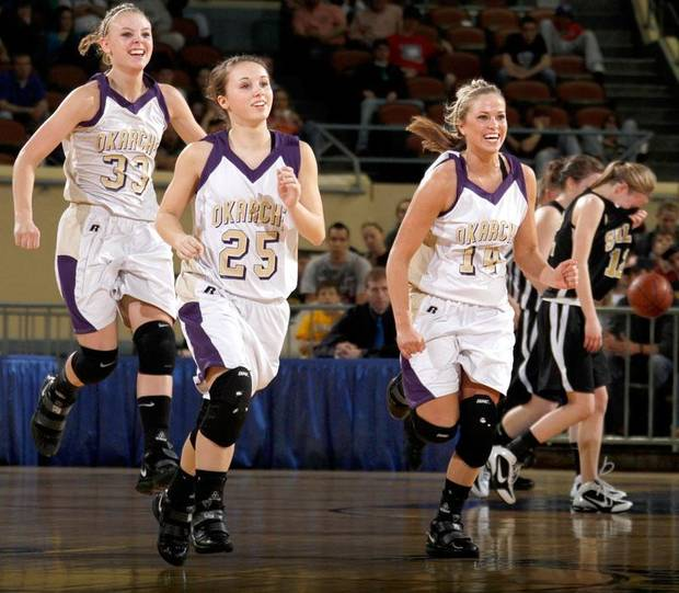Okarche's Kristen Meyer, left, Brooke Edwards, and Macy Kunneman celebrate as Seiling's Aubrey Colvard walks off the court during the Class A girls basketball state tournament at the State Fair Arena in Oklahoma City, Friday, March 5, 2010.  Photo by Bryan Terry, The Oklahoman