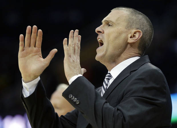 Dallas Mavericks head coach Rick Carlisle yells to his team in the first quarter of an NBA basketball game against the Cleveland Cavaliers, Saturday, Nov. 17, 2012, in Cleveland. (AP Photo/Mark Duncan)
