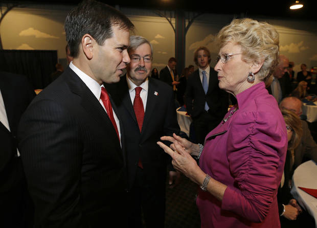 Teresa Garman talks with U.S. Sen. Marco Rubio, R-Fla., left, during Iowa Gov. Terry Branstad's annual birthday fundraiser, Saturday, Nov. 17, 2012, in Altoona, Iowa. (AP Photo/Charlie Neibergall)