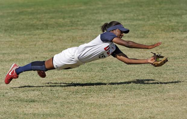 Michelle Moultrie (15), a left-fielder for team U.S.A., dives for a ball during a game between The United States and Great Britain at the World Cup of Softball at the ASA Hall of Fame Stadium in Oklahoma City, Sunday, July 24, 2011.  Photo by Garett FIsbeck, The Oklahoman ORG XMIT: KOD