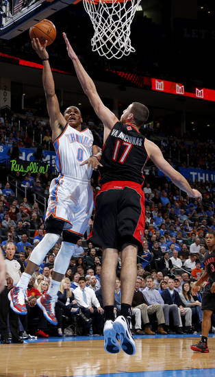 Oklahoma City's Russell Westbrook (0) goes past Toronto's Jonas Valanciunas (17) during an NBA basketball game between the Oklahoma City Thunder and the Toronto Raptors at Chesapeake Energy Arena in Oklahoma City, Tuesday, Nov. 6, 2012.  Tuesday, Nov. 6, 2012. Photo by Bryan Terry, The Oklahoman
