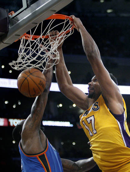 Los Angeles' Andrew Bynum (17) dunks on Oklahoma City's Kendrick Perkins (5) during Game 4 in the second round of the NBA basketball playoffs between the L.A. Lakers and the Oklahoma City Thunder at the Staples Center in Los Angeles, Saturday, May 19, 2012. Photo by Nate Billings, The Oklahoman