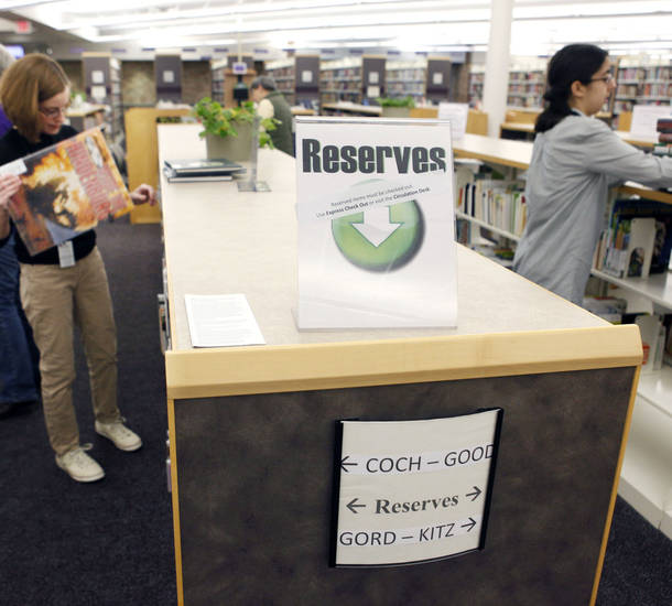 The new self-serve reserve system occupies several bookshelves at the Edmond Library. The system is in place at four other branches, as well.
