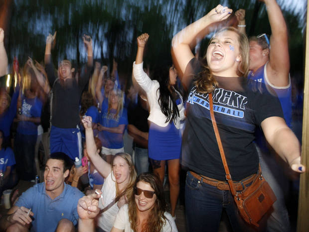   Kentucky fans celebrate Kentucky&#039;s 69-61 win over Louisville in an NCAA Final Four semifinal college basketball tournament game, Saturday, March 31, 2012, in Lexington, Ky. (AP Photo/The Courier-Journal, Amy Wallot) NO SALES; MAGS OUT; NO ARCHIVE; MANDATORY CREDIT  