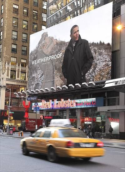 A garment manufacturer's ad featuring President Obama was pulled from Times Square.