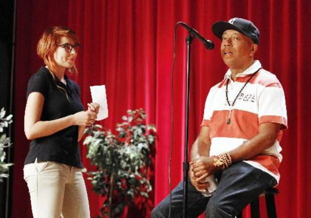 Russell Simmons, co-founder of the hip-hop label Def Jam and creator of the clothing fashion line Phat Farm, answers a question asked by Willow Gravitt, a junior age 16, as Simmons speaks at John Marshall High School in Oklahoma City. Photo by Paul B. Southerland, The Oklahoman