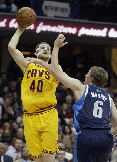 Cleveland Cavaliers' Tyler Zeller (40) shoots over Dallas Mavericks' Troy Murphy (6) in the second quarter of an NBA basketball game on Saturday, Nov. 17, 2012, in Cleveland. (AP Photo/Mark Duncan)