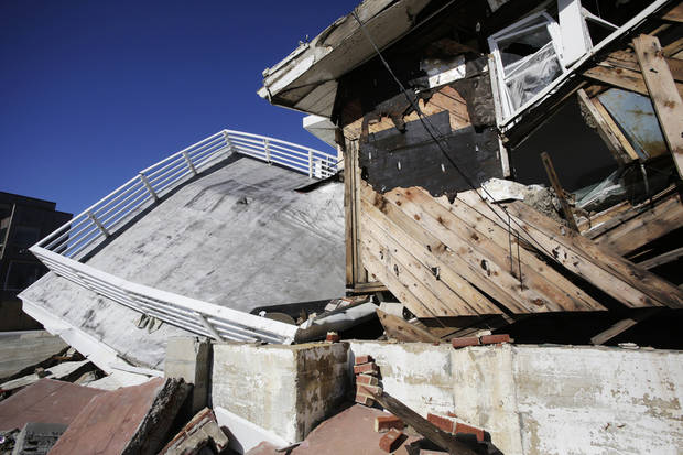 A storm-damaged beachfront house is shown in the Far Rockaways, Thursday, Jan. 31, 2013 in the Queens borough of New York. Three months after Superstorm Sandy ravaged coastal areas in much of the Northeast, Congress on Monday, Jan. 28 passed a $50.5 billion emergency aid package for storm victims. (AP Photo/Mark Lennihan)