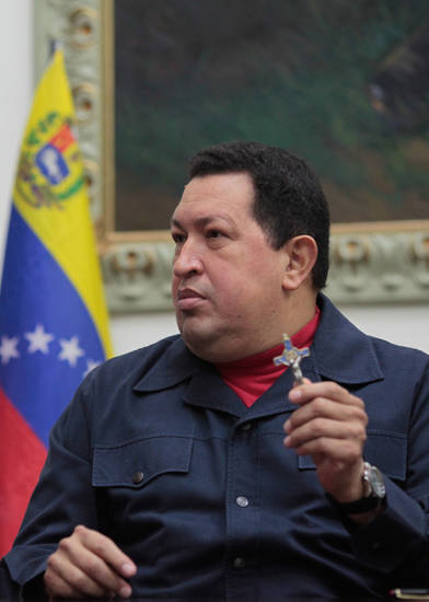 In this photo released by Miraflores Press Office, Venezuela's President Hugo Chavez holds up a crucifix  during a televised speech form his office at Miraflores Presidential palace in Caracas, Venezuela, Saturday, Dec. 8, 2012. Chavez announced Saturday night that his cancer has returned and that he will undergo another surgery in Cuba. Chavez, who won re-election on Oct. 7, also said for the first time that if his health were to worsen, his successor would be Vice President Nicolas Maduro.(AP Photo/Miraflores Press Office, Marcelo Garcia)